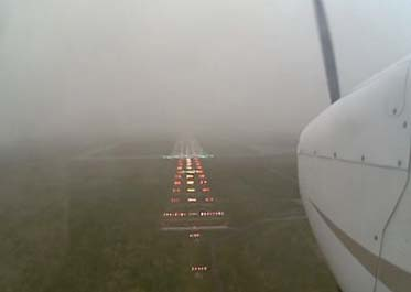 picture of a pilot performing an instrument approach on a foggy day
