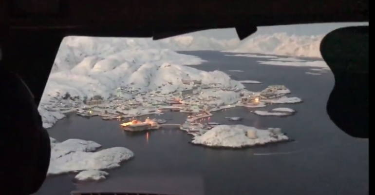 beautiful views as this aircraft completes an approach in greenland